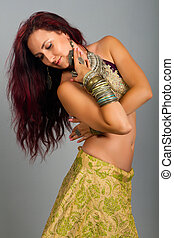 Beautiful girl belly dance movemen