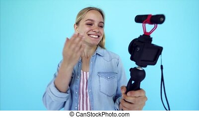 Beautiful girl blogger relieves itself at camera isolated...