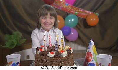 Beautiful girl blowing candles