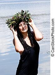 Beautiful girl bohemian style in the lake