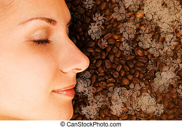 Beautiful girl breathing in scent of coffee