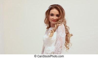 beautiful girl bride in wedding dress posing laughs white