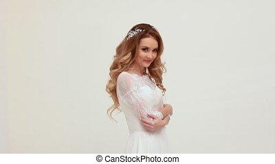 beautiful girl bride in wedding dress posing laughs white...