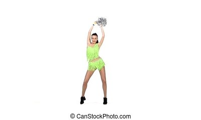 beautiful girl cheerleader dances on a white background with pompoms