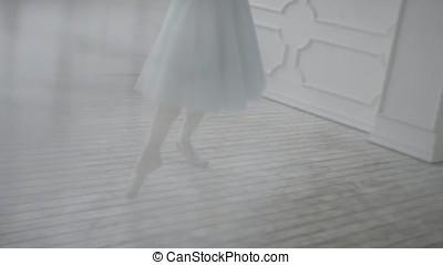 Beautiful Girl Dancer Performs Elements Of Classical Ballet In The Loft Design. Female Ballet Dancer Dancing. Close Up Of A Ballet Dancer's Feet As She Practices Point Exercises,slow Motion
