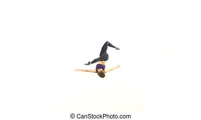 Beautiful girl dancing contemp on white background