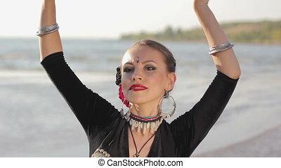 Beautiful  girl dancing exotic dance on nature
