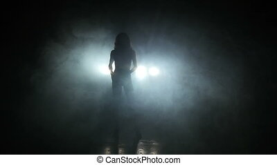 Beautiful girl dancing in the dark