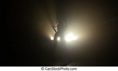 Beautiful girl dancing passionately in the studio