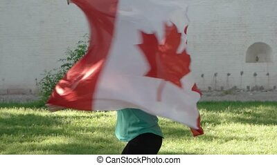 Beautiful girl dancing with a Canada flag