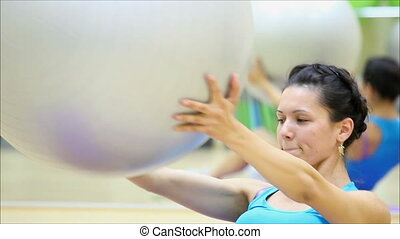 beautiful girl does exercises with the ball at the gym 5