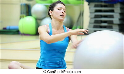 beautiful girl does exercises with the ball at the gym 11