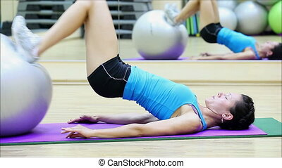 beautiful girl does exercises with the ball at the gym 3
