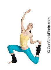 beautiful girl doing gymnastics on white background