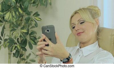 Beautiful girl doing selfie on phone