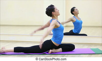 beautiful girl doing yoga in a gym 1