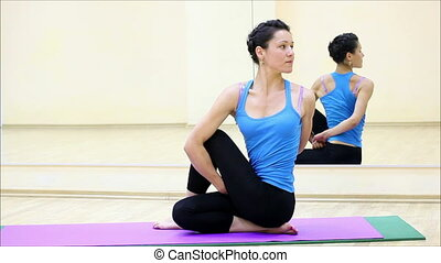 beautiful girl doing yoga in a gym