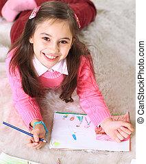 Beautiful girl draws.