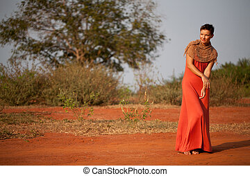 Beautiful girl dressed  terracotta dress