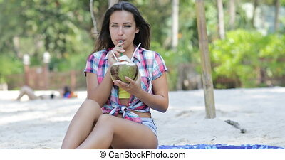 Beautiful Girl Drink Coconut Cocktail Sit On Beach Over Palm...