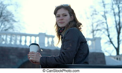 Beautiful girl drinking coffee on the street 4k