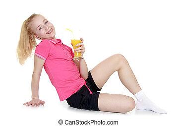Beautiful girl drinking orange juice