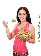 beautiful girl eat salad