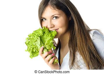 beautiful girl eating salad - portrait of a beautiful happy ...