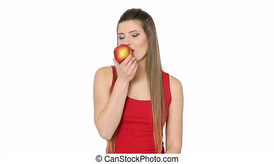 beautiful girl eats red apple on white background