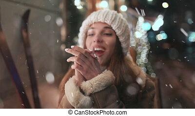 Beautiful Girl Enjoying Snowfall in the Town