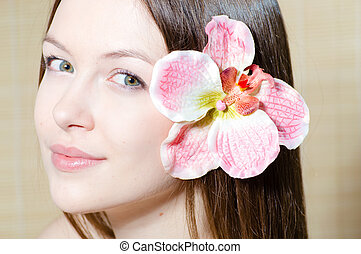 beautiful girl face & flower. Perfect skin. - Portrait of a...