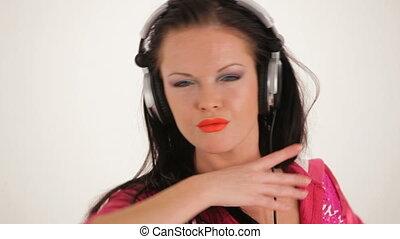 Beautiful girl face with headphones.
