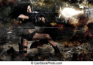 beautiful girl firing a machine gun - View of a beautiful...