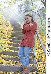 Beautiful girl freezing in autumn