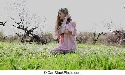 beautiful girl gathers wildflowers in the garden - beautiful...
