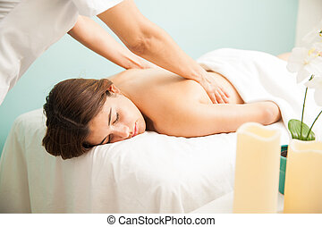 Beautiful girl getting a back massage
