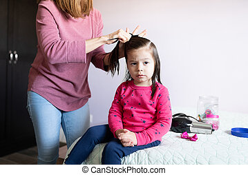 Beautiful girl getting a hairdo at home