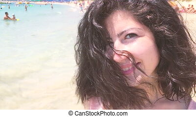 Beautiful brunette girl going to the beach slow motion.