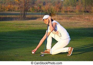 beautiful girl golf player on field