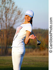 beautiful girl golf player posing