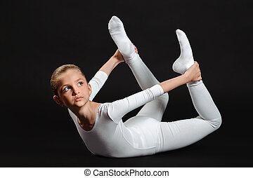 beautiful girl gymnast doing exercises