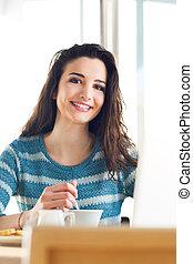 Beautiful girl having a coffee break at the bar
