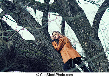 Beautiful girl hipster among the trees