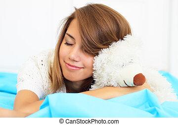 Beautiful girl holding a bear