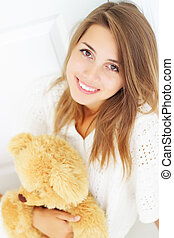 Beautiful girl holding a bear