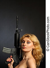 Beautiful girl holding a rifle