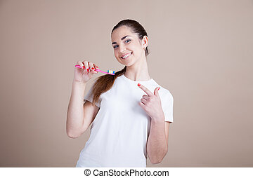 beautiful girl holding a toothbrush