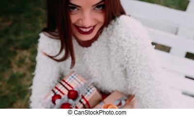 Beautiful girl holding gift
