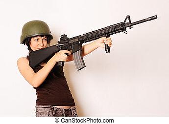 girl holding gun