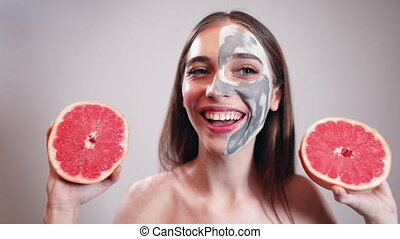 Beautiful Girl holding Juicy Grapefruit - Beautiful naked...